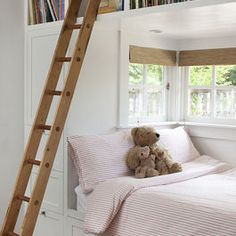Elevated book storage; placement of bed by window