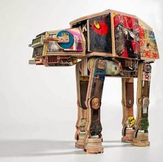 Brilliant idea to reconcile geeks and hipsters! Star wars at-at walker made from repurposed skateboard decks.