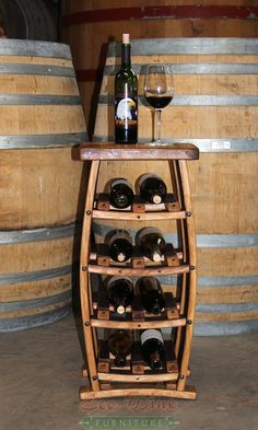 Surf a wide array of wine shelf models, inclusive of barrier affixed mauve stages and unique beer bottle keepers. Wine Barrel Crafts, Wine Barrel Table, Wine Barrel Furniture, Wine Barrels, Cool Wine Racks, Barris, Barrel Projects, Wine Glass Rack, Wine Decor
