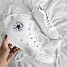 175b3c4f83b All white women s Chuck Taylor all star classic converse sneakers. At  TheShoeCosmetics all white trainers are the canvas