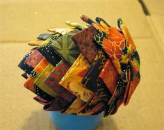 Pretty pine cone from fabric scraps! Complete instructions for this ornament are at http://auntreensplace.blogspot.com/2013/11/pinecone-ornament-pattern.html