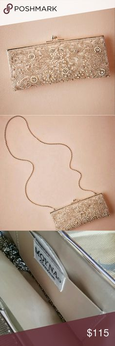"""Moyna Tearoom Clutch from BHLDN Still sold at BHLDN! Barely used. I had it for my wedding and it stayed on the table all night! No beads missing or stains. Almost perfect condition. Comes with dust bag!  Here are the details from bhldn online:   Beads, crystals, and pearls create a stunning and elegant motif atop this glamorous clutch.  A BHLDN exclusive By Moyna Fits iPhone, tissue pack, lipstick, compact mirror, dental floss, and powder Hidden chain strap; kisslock closure 4""""H, 8.5""""W, 1""""D…"""