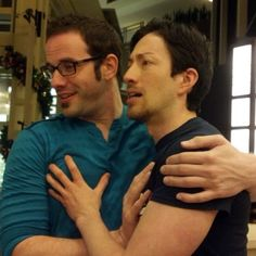 Todd Haberkorn and J. Michael Tatum grabbing each other's man breasts. You're welcome.