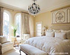 Custom bedding made by Nancy Osborne graces the serene master suite.