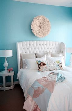 turquoise bedroom with white upholstered bed, pantone island paradise, light turquoise, baby blue, sky blue, caribbean blue, aqua blue