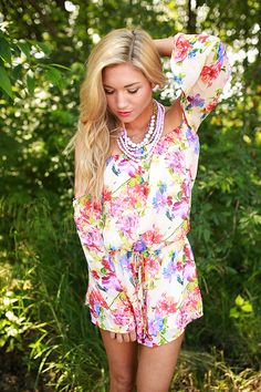We're obsessed with floral rompers this season and this vibrant beauty is no exception!