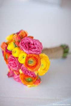 Orange, pink, and yellow bouquet- all these are pretty cheap flowers too, add some white ones and a lil green in there and tie them off with long ribbons =]