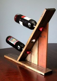 3 bottle wine holding display rack made from a pallet