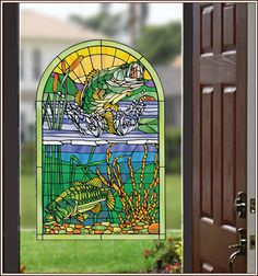Big Fish Creek stained glass accent features vivid colors and images.