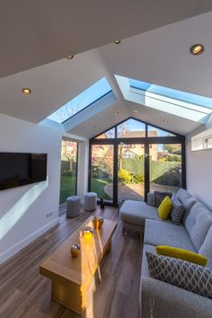 This stunning home extension features the Ultraroof tiled conservatory roof. On the inside the vaulted ceiling is plastered and allows you to insert spotlights. It also features full length glass panels that allow the roof to flood with natural light. Replacement Conservatory Roof, Tiled Conservatory Roof, Conservatory Decor, Conservatory Kitchen, Conservatory Extension, Conservatory Interiors, House Extension Plans, House Extension Design, Kitchen Extension Into Garage