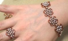 How to Make a Japanese 12-in-2 Chain Maille Bracelet and Ring from Beadaholique-  I LOVE THIS TUTORIAL!