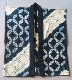 This piece features shibori done in orinui and shirokage (white shadow) styles. The white bands would have been bound and reserved during the dye process, making this a rather labor intensive textile. Dyeing would have involved several different steps to achieve the overall multi-hued effect.