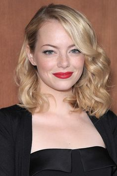 Emma Stone's side-swept curls DO team your shoulder-length side-swept curls with a hot red lip for a look as gorgeous as Emma Stone's.