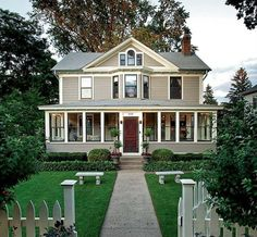 Craftsman Exterior of Home - Come find more on Zillow Digs! - red door, tan paint - screened in porch with glass -
