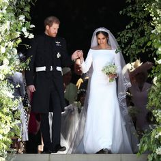 May 19, 2018 Prince Harry & Meghan Markle's Royal Wedding: The couple are greeted by cheers from the crowd as they leave the ceremony. Photo: Shutterstock