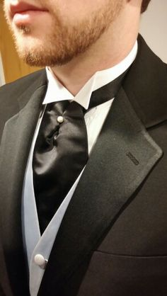 Dark flat gray vest black cravat