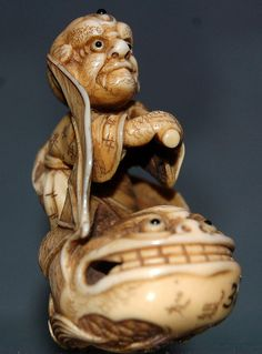 Man riding fish Netsuke    18-19th century.        At the György Ráth Museum in Budapest