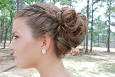 I did two french braids on either side of her head, combined them at the side with a messy bun full of curls. Prom hairstyle.