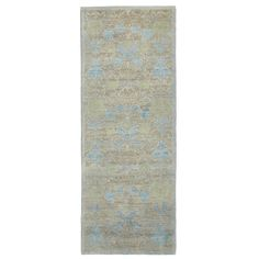 A floral pattern in sky blue hues is faintly visible within the striated taupe ground on this one-of-kind rug from the Color Reform Spectrum collection. Handwoven from wool, it was created in Pakistan using centuries-old techniques. Harnessing the natural energy of the sun, each rug is organically neutralized from its original color and then overdyed and washed in remarkable chromatic hues to produce a revolutionary work of art.