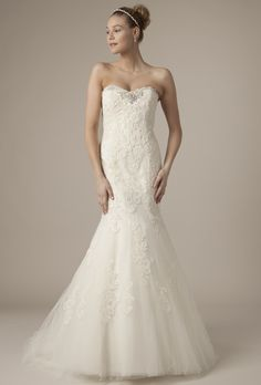 Brides.com: Alita Graham - Spring 2014. Strapless lace mermaid wedding dress with embellished sweetheart neckline and tulle skirt.