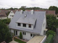 Wohnhaus mit großer Dachgaube. Dacharbeiten der Kemker GmbH Bedachungen in Ludwigsburg (71638) | Dachdecker.com