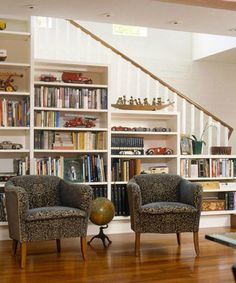 Clever use of space - shelves under the stairs to display books and fill up space - home library design