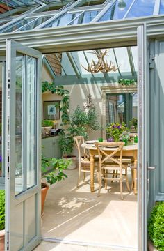 Through the door of a lovely little conservatory dining room!