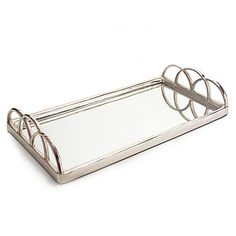 Gleaming all over in polished silver finish and mirrored glass, the John-Richard Silver Mirrored Tray serves up elegant style. Delicate arched handles complete this glamorous look.