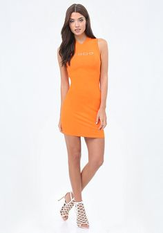 Make it a mini. Sexy little mini dress in a curve-flattering rib knit with eye-catching back lace-up detail. Glittering front bebe logo.
