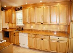 Kraftmaid ginger glaze cabinets with granite countertops for Birdseye maple kitchen cabinets