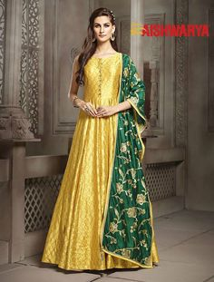 A truly royal suit, this one is fit for a queen! Buy Suit online - http://www.aishwaryadesignstudio.com/glossy-yellow-dress-with-green-dupatta