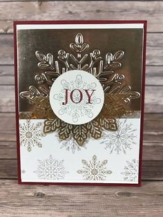 Stampin Up! Christmas Card -Champagne Foil JOY Christmas Card Class Kit. - Includes (1) 4 1/4 x 5 1/2 card with envelope. -Stampin Up! Cardstock and Designer Series Paper used to create the Card. -Includes everything needed to create the Card. You only need adhesive to finish kit. -COMPLETELY CUT, Stamped, and Punched and papers stacked in order and ready to assemble. -Includes Stampin Up Cardstock and SU Designer Paper, SU Champagne Foil Paper, SU Metallic Snowflake, and Stampin Up...