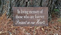 I love this Etsy listing:  https://www.etsy.com/listing/250594955/in-loving-memory-wooden-wedding-sign