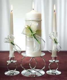 Add a little class to your wedding ceremony with the Calla Lily in the Bridal Beauty Calla Lily Unity Ceremony Candles. The unity pillar candle is designed with small delicate ribbons and features handcrafted porcelain Calla Lily flowers accented by a large white sheer ribbon. The matching lighting candles have sheer white ribbon and handcrafted porcelain Calla Lily flowers as well.$55.00