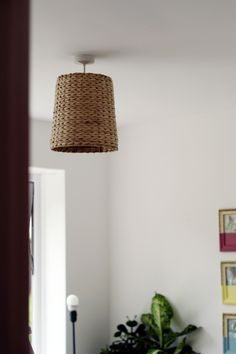DIY Woven Basket - I've done this a dozen times..  It's always a great inexpensive way to dress up a light fixture.