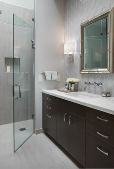 Found this on Houzz. I like the dark wood vanity, honeycomb pattern gray tile and somewhat hidden shower.