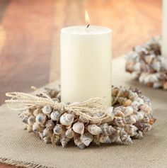 """Chulla shells are hand-threaded to form layers of natural shell beauty. Nestle in a candle, and let the shells speak for themselves. Measures 8"""" across by 3"""" high."""