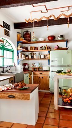 This homeowner wanted to blend her family's desire for a back-to-our-roots lifestyle with their love for color, ethnicity and variety. Refrigerator and Retro dishwasher, both in Jadeite Green from Big Chill. #Retro #Kitchen