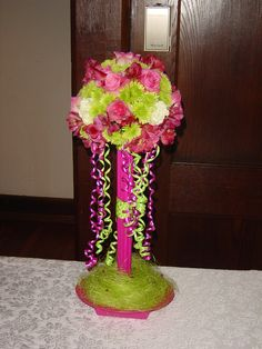 Bright pink & green wedding:  Flowers for the gift table designed by Whimsical Welcomes Floral Design