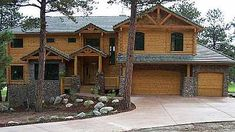 Need a garage in your log home plans? :) Log Home Design Plan and Kits for Cherokee