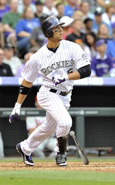 Rockies leftfielder Carlos Gonzalez follows through on an RBI double in the third inning.
