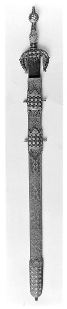 Espada Jineta perteneciente al The Metropolitan Museum of Art de Nueva York.  Sword with Scabbard Date: late 15th century Culture: Spanish Medium: Steel, copper gilt, enamel, silver, leather, metallic thread Dimensions: L. of sword 37 1/2 in. (95.3 cm); L. of scabbard 30 1/4 in. (76.8 cm)