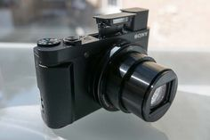 Sony HX90V. Beautiful travel zoom. I will be buying a pair when released the summer of 2015.