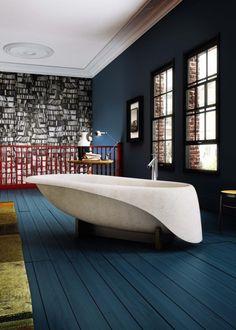 Glass Idromassaggio's Concrete Soft bathtub is made fromDuctalR concrete and bears the signature of the designer Gigi Rossi.