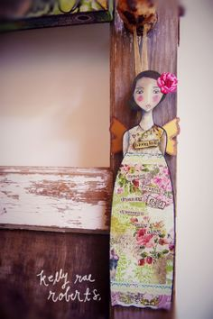 Blooming is available here . Don't forget she hangs OR you can drop her inside our super cool display stand.