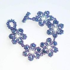 Blue Flower Bracelet, Crystal and Purple Beads Woven Into Spring Flowers links - $45.00