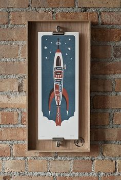 Blastoff - On wall 5 by Running Doves Press, via Flickr. This is a great way to present any poster designs in a portfolio.