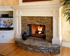 I like the fireplace, but would put the tv above fireplace or in a closed cabinet.