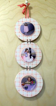 Old CDs with scrapbook paper and photos. Holes made with a Crop-A-Dile and attached with Bind-It-All