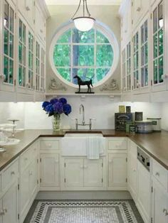 'Small but perfectly formed' galley Kitchen. :-) New England style cabinet windows echoed in the round portal window.  #interior #decor